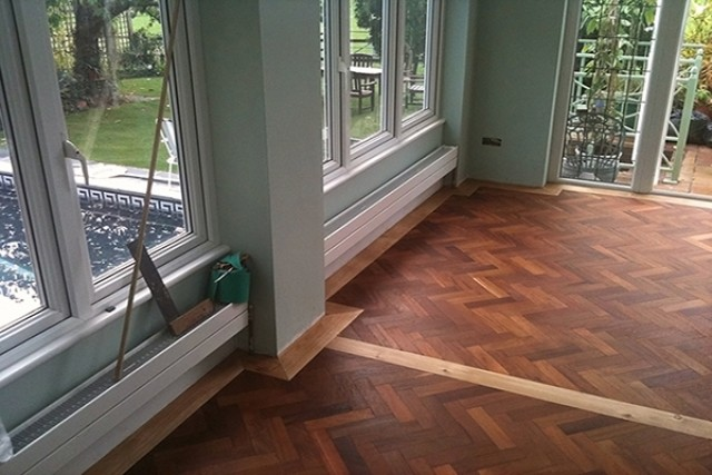 Herringbone parquet floor installation
