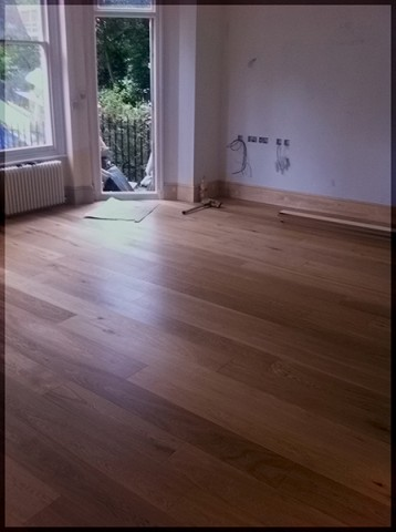 Wide boards solid oak installation in Kensington (West London)