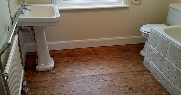Bathroom floor renovation in Leatherhead