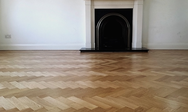 Herringbone oak parquet restoration in Esher