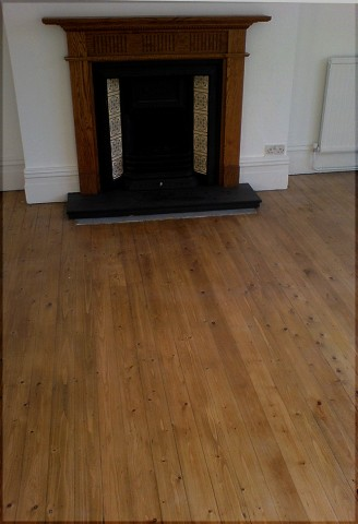 Victorian floorboards stained by light oak and varnished